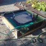 2013-06-01 Jag byggde en låda med presenning och vatten för att provtrycka kylarna. Så gamla - och täta...!