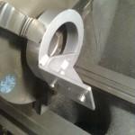 2013-10-19  Fixtur för att hålla kedjesträckarens glidklots i svarven för att kunna skära rätt radie